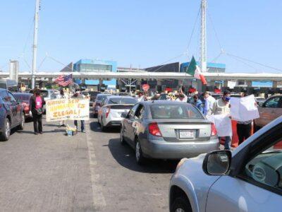 AMLO en EU: Protestan en la frontera por políticas antimigrantes