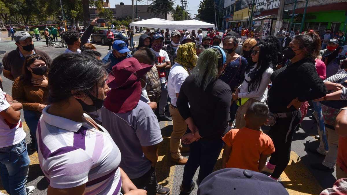 Puebla: comerciantes arman campal en la capital; ve VIDEOS
